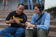 Chris Hufstader (right), communicator for Oxfam America, interviews Hector Berrios, general coordinator of MUFRAS-32 and anti-mining activist, during the VIII Festival for sovereignty and the People's right to self-determination in San Isidro's central park. San Isidro, Cabañas, El Salvador. September 15, 2014.