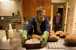 Stanford after dark. Stanford sophmore, Katherine Boubos bakes bread at the Columbay co-op. Jess Steinberg, (jr) comes down for a late night snack.