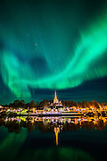 """Sometimes nature is so perfect that it is hard to believe.Believe it or not this is a reall picture all the reflections and lights are without any changes. Aurora over Nidarosdomen (Domkirke) Nidaros Cathedral is a Church of Norway, located in the city of Trondheim in Sør-Trøndelag county, Norway. Built over the burial site of Saint Olaf, the king of Norway in the 11th century, who became the patron saint of the nation.It was such a clear sky in Trondheim with fabulous northern light. It was so strong that you could see the dancing light even inside the city with all those light pollutions. Please feel free to find me by: <a href=""""http://www.aziznasutiphotography.com/"""">