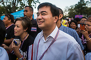 "13 JANUARY 2014 - BANGKOK, THAILAND: Former Thai Prime Minister ABHISIT VEJJAJIVA, a leader of the Democrat party, walks through the anti-government protest in Lumpini Park. Abhisit and all of the other Democrats, the opposition party in Thailand, resigned from Parliament and are not participating in the coming election. Tens of thousands of Thai anti-government protestors took to the streets of Bangkok Monday to shut down the Thai capitol. The protest was called ""Shutdown Bangkok"" and is expected to last at least a week. The Shutdown Bangkok protest is a continuation of protests that started in early November. There have been shootings almost every night at different protests sites around Bangkok, including two Sunday night, but the protests Monday were peaceful. The malls in Bangkok stayed open Monday but many other businesses closed for the day and mass transit was swamped with both protestors and people who had to use mass transit because the roads were blocked.    PHOTO BY JACK KURTZ"