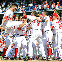 25 July 2013:  Washington Nationals left fielder Bryce Harper (34) leaps in the air and is greeted by his teammates after hitting his first career game winning walk off home run in the 9th inning against the Pittsburgh Pirates at Nationals Park in Washington, D.C. where the Washington Nationals defeated the Pittsburgh Pirates, 9-7.