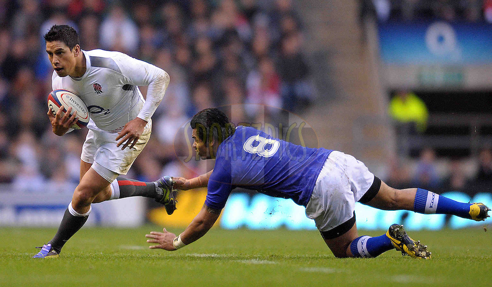 © SPORTZPICS / SECONDS LEFT IMAGES 2010 - Rugby Union - Investec Challenge - England v Samoa - 20/11/10 - England's Shontayne Hape beats the tackle of Samoa's George Stowers to open an attack - at Twickenham Stadium UK - All rights reserved