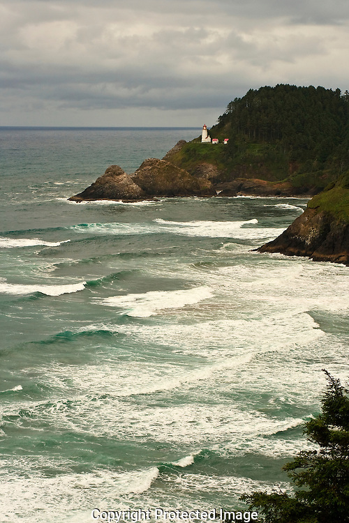 Summer storm Heceta Head Lighthouse coast of Oregon.