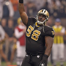 Oct 31, 2010; New Orleans, LA, USA; New Orleans Saints defensive tackle Sedrick Ellis (98) pumps up the crowd prior to a game against the Pittsburgh Steelers at the Louisiana Superdome. Mandatory Credit: Derick E. Hingle