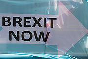 On the day that the EU in Brussels agreed in principle to extend Brexit until 31st January 2020 (aka 'Flextension') and not 31st October 2019, a Union Jack flag is seen through a Brexit Party flags and banners during a Brexit protest outside parliament, on 28th October 2019, in Westminster, London, England.
