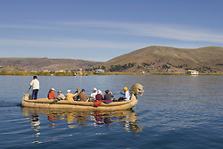 Boats made of reeds transport tourists, Uros Islands (also known as Floating Islands or Islas Flotantes), Lake Titicaca, Peru, South America
