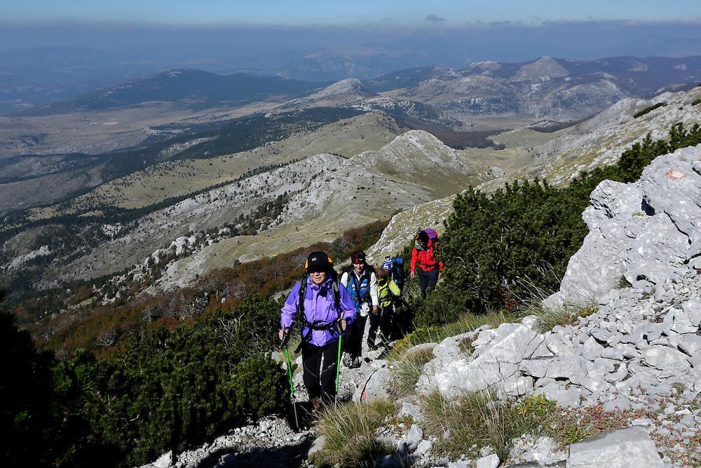Via Dinarica team, hiking on Dinara mountain in cold wind, <br /> Croatia.
