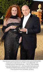 Newspaper editor REBECCA WADE and actor ROSS KEMP, at a party in Berkshire on 27th June 2002.	PBK 121