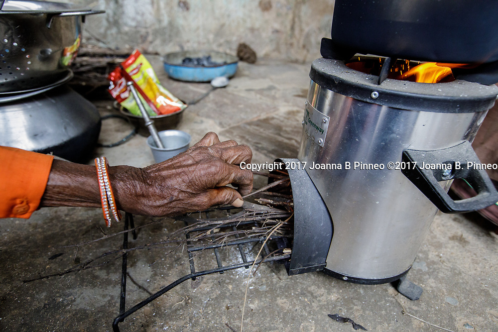 "Shanti Bai makes tea for visitors and her employees using her Greenway Smart Stove to make the tea.  Greenway stoves are made in India. Greenway says that their stoves deliver 60% fuel savings and 70% smoke reduction than the traditional ""chulha"" or mud stove. Shanti Bai runs a weaving business out of her home with seven looms and twenty-eight women employees. She is part of the Jaipur Rug Foundation weavers. Shanti also uses LPG to cook larger meals and the ""chuhla"" to cook the chapati or flatbread that is a staple in Indian homes. Often families who have switched to cleaner cooking stoves still practice ""stove stacking"" which is using more than one type stove at a time, usually the traditional stove and the cleaner one. Some use the traditional stove for specific types of traditional food and some use both at the same time. It can take time for the family cook, usually the woman, to switch completely to the cleaner cooking stove. Shanti Bai says she uses the LPG stove and the Greenway most of the time but still uses the ""chulha"" for making roti or chapatis. Shanti Bai makes tea for visitors and her employees using her Greenway Smart Stove to make the tea. Greenway stoves are made in India. Greenway says that their stoves deliver 60% fuel savings and 70% smoke reduction than the traditional ""chulha"" or mud stove. Shanti Bai runs a weaving business out of her home with seven looms and twenty-eight women employees. She is part of the Jaipur Rug Foundation weavers. Shanti also uses LPG to cook larger meals and the ""chuhla"" to cook the chapati or flatbread that is a staple in Indian homes. Shanti Bai says she uses the LPG stove and the Greenway most of the time but still uses the ""chulha"" for making roti or chapatis."