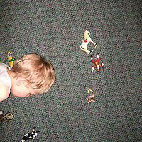 A child playing with small toys