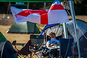 Sleeping off the night before an exhausted England fan - The 2018 Latitude Festival, Henham Park. Suffolk 14 July 2018