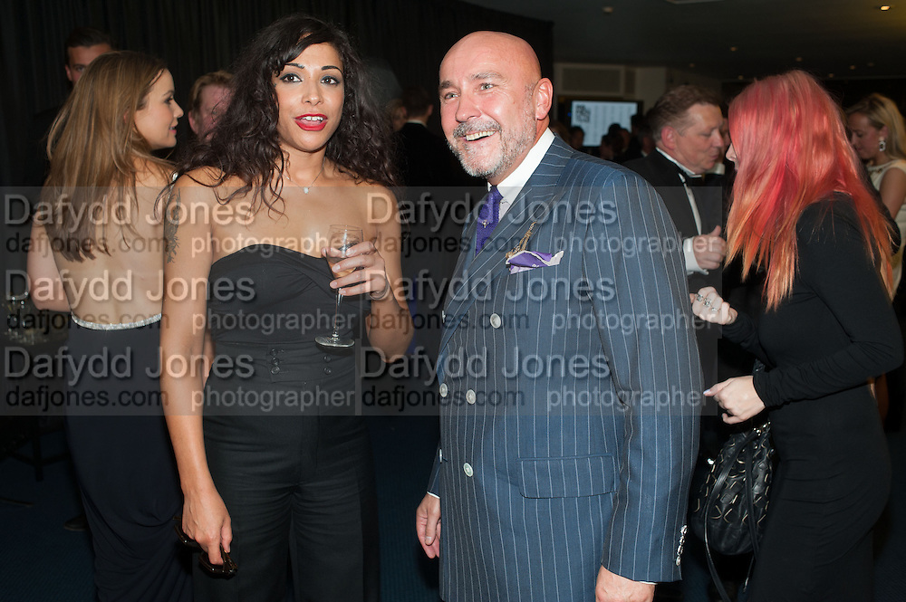 CHERISE COLLINGS; MARK POWELL, 2012 GQ Men of the Year Awards,  Royal Opera House. Covent Garden, London.  3 September 2012