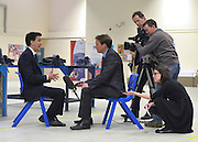 © Licensed to London News Pictures. 14/02/2013. Bedford, UK. Ed Miliband takes part in a television interview. Ed Miliband MP, Leader of the Labour Party, delivers a major speech at Bedford Training Group in Bedford today, 14th February 2013. In the speech he set out a 'One Nation Labour agenda for rebuilding Britain's economy'. The speech was followed by a Q&A session with Ed Balls, Shadow Chancellor and a tour of the training facility. Photo credit : Stephen Simpson/LNP