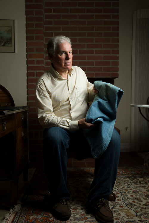 Howard Green stands for a portrait at his home on Thursday, Aug. 10, 2017, in Los Gatos, Calif. Green holds the pants he wore when he was wounded in the Golden Dragon massacre in San Francisco Chinatown on Sept. 4, 1977. His pants have three bullet holes and blood stains from the incident. The middle-of-the-night gang shooting at the packed Golden Dragon restaurant left five dead and wounded at least 11. None of the victims were the intended targets of the shooting.