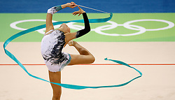 South Korea's Shin Sooji performs with the ribbon during the individual all-around qualifications for rhythmic gymnastics during the Olympic games in Beijing, China, 22 August 2008.