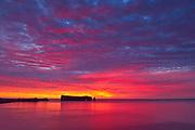 Le Rocher Percé or Percé Rock in the Atlantic Ocean at sunrise<br />Percé<br />Quebec<br />Canada