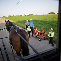 "An Amish family walks to their friends house for a visit as seen on a buggy tour through Lancaster County, PA on August 9, 2014.  A bevy of Amish themed reality television shows (Amish Mafia, Breaking Amish, Return to Amish and Amish Haunting - to be televised soon) have prompted controversy over the negative portrayal.  One woman, a Mary Haverstick, a film maker, has launched a website in support of the Amish (respectamish.org) and has garnered the support of 3,000 businesses.  Her motivation to start the website was to ""end the bigoted programming.""  REUTERS/Mark Makela (UNITED STATES)"