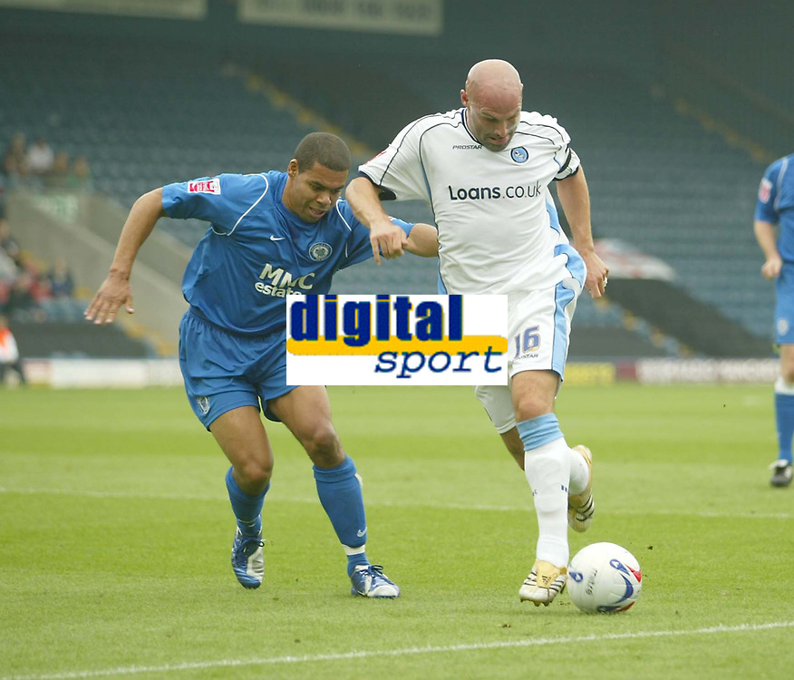 Photo: Aidan Ellis.<br /> Rochdale v Wycombe Wanderers. Coca Cola League 2. 16/09/2006. <br /> Wycombe's Tommy Mooney is closely watched by Rochdale's Nathan Stanton