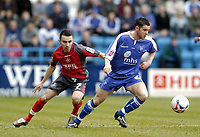 Photo: Olly Greenwood.<br />Gillingham v Swansea City. Coca Cola League 1. 25/03/2006.Gillingham's Matthew Jarvis and Swansea's Leon Britton (L).