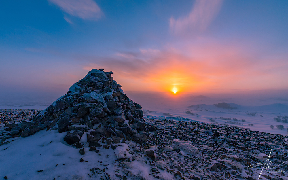 Sunrise over the frozen grassland of Inner Mongolia