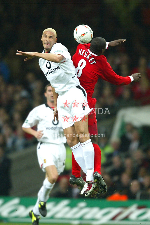 CARDIFF, WALES - Sunday, March 2, 2003: Liverpool's Emile Heskey and Manchester United's Rio Ferdinand during the Football League Cup Final at the Millennium Stadium. (Pic by David Rawcliffe/Propaganda)