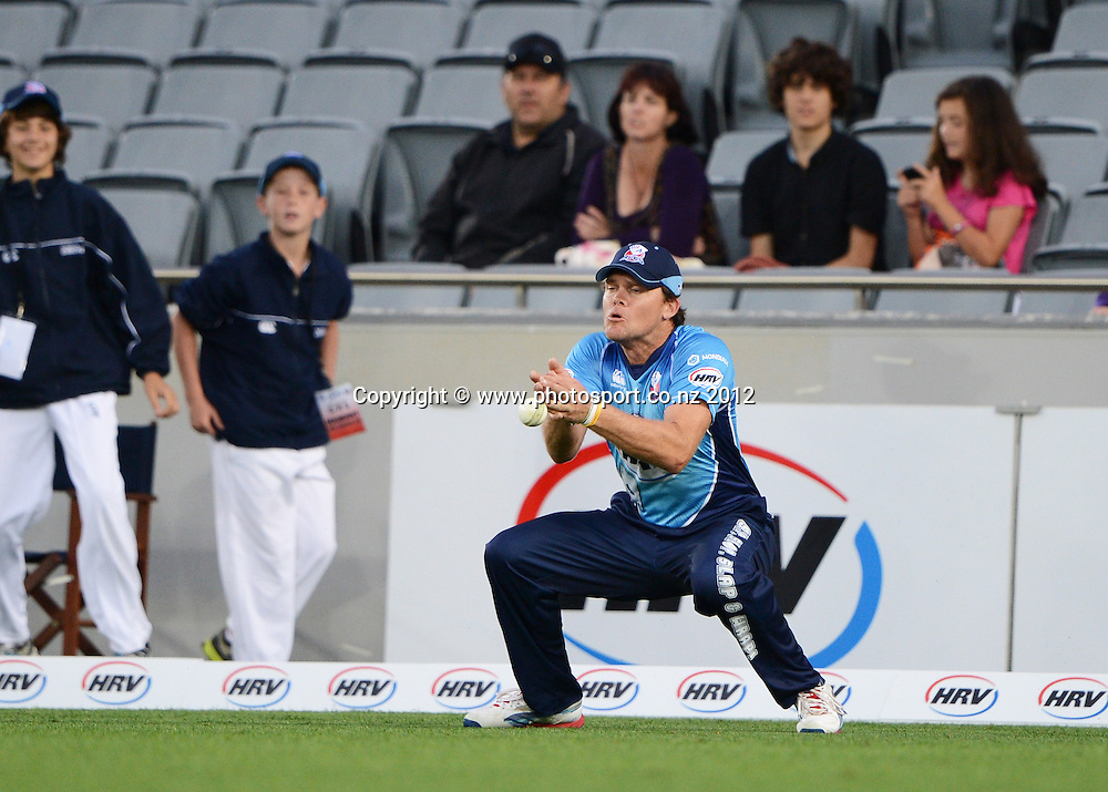 Lou VIncent drops a catch in the outfield during the HRV Cup Twenty20 Cricket match between Auckland Aces and Wellington Firebirds at Eden Park on Friday 28 December 2012. Photo: Andrew Cornaga/Photosport.co.nz