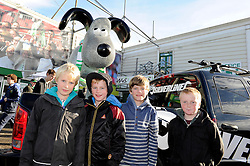 Young fans pose outside with the Yeovil Town FC gromit outside Huish Park on Sunday 10th October - Photo mandatory by-line: Dougie Allward/JMP - Tel: Mobile: 07966 386802 10/11/2013 - SPORT - FOOTBALL - Huish Park - Yeovil - Yeovil Town v Wigan Athletic - Sky Bet Championship