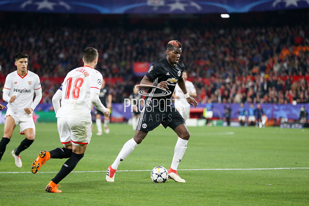 Manchester United Midfielder Paul Pogba battles with Sevilla defender Sergio Escudero (18) during the Champions League match between Sevilla and Manchester United at the Ramon Sanchez Pizjuan Stadium, Seville, Spain on 21 February 2018. Picture by Phil Duncan.