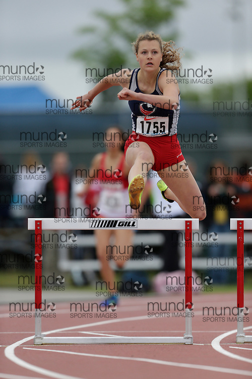Lexi Aitken of St Anne's CSS - Clinton competes in the intermediate hurdle heats at the 2013 OFSAA Track and Field Championship in Oshawa Ontario, Saturday,  June 8, 2013.<br /> Mundo Sport Images/ Geoff Robins