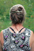 back view of middle aged woman in nature setting