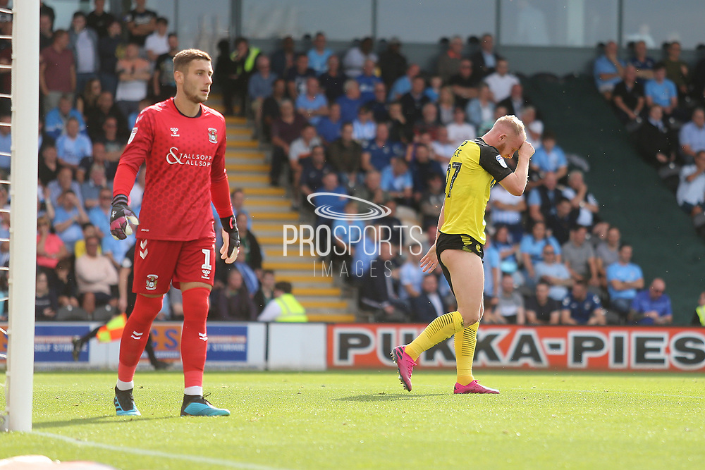 Burton Albion forward Liam Boyce (27) reacts to missing a chance during the EFL Sky Bet League 1 match between Burton Albion and Coventry City at the Pirelli Stadium, Burton upon Trent, England on 14 September 2019.