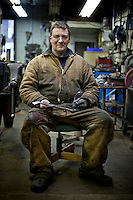 Blacksmith Arnon Kartmazov in Portland, Oregon. He makes chef's knives in his forge.
