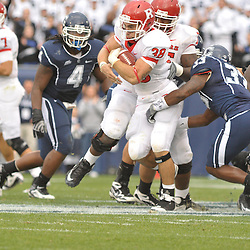 Oct 31, 2009; East Hartford, CT, USA; Rutgers running back Joe Martinek (38) runs through the first of several tackle attempts during second half Big East NCAA football action in Rutgers' 28-24 victory over Connecticut at Rentschler Field.