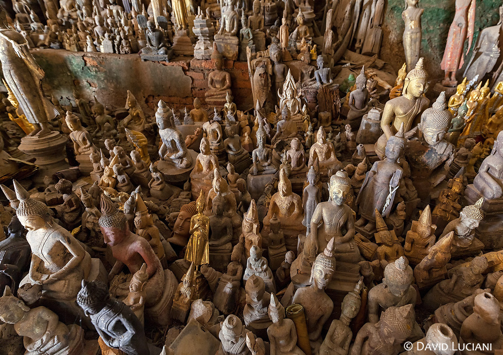 The lower Pak Ou cave is filled with thousands of Buddha statues.