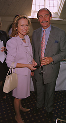 MR & MRS JULIAN HIPWOOD he is the leading polo player, at a reception in London on 20th May 1999.MSH 32