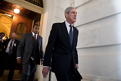 October 30, 2017 - (File Photo) - Special Counsel Robert Mueller's criminal investigation into alleged Russian meddling in the 2016 presidential election, includes Donald Trump's former presidential campaign manager, Paul Manafort, who has been charged on 12 counts, including conspiring to defraud the US in his dealings with Ukraine.  PICTURED: June 21, 2017  Washington, D.C., U.S. -  Former FBI Director ROBERT MUELLER (front), the special counsel probing Russian interference in the 2016 U.S. election, leaves the Capitol building after meeting with the Senate Judiciary Committee on Capitol Hill. (Credit Image: © Ting Shen/Xinhua via ZUMA Wire)