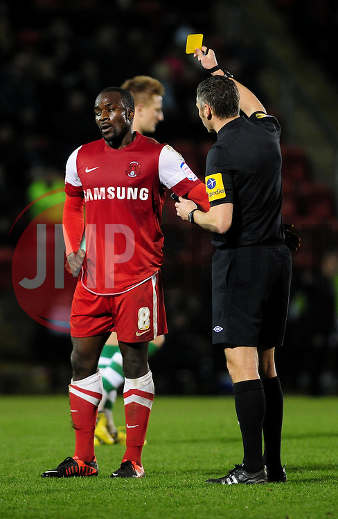 Leyton Orient's Anthony Griffith receives his first yellow card after fouling Yeovil Town's Gavin Williams - Photo mandatory by-line: Dougie Allward/JMP - Tel: Mobile: 07966 386802 09/01/2013 - SPORT - FOOTBALL - Matchroom Stadium - London -  Leyton Orient v Yeovil Town - Johnstone's Paint Trophy Southern area semi-final.