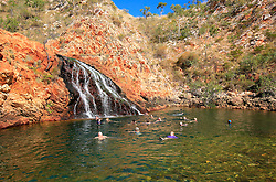 Tourists from one of the Kimberley charter boats swimming at Croc Creek on the Kimberley coast.