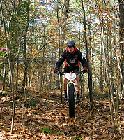 maneuvers his fat bike through cross country and snowshoe trails at Gunstock Nordic for the Fall Flurry mountain bike race held on Saturday morning.  (Karen Bobotas/for the Laconia Daily Sun)