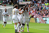Swansea city players celebrate after their opening goal scored by Wayne Routledge ®. Barclays Premier league, Swansea city v Sunderland at the Liberty Stadium in Swansea, South Wales on Saturday 1st Sept 2012. pic by Andrew Orchard, Andrew Orchard sports photography,