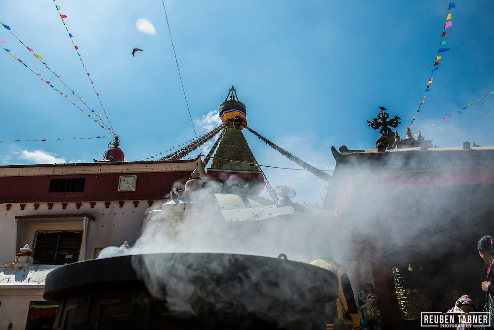 Smoke rises from a cauldron of burning incense next to the Boudhanath Stupa in Kathmandu, Nepal.