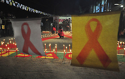 AGARTALA, Dec. 1, 2016 (Xinhua) -- People light candles during an AIDS awareness program on the eve of World AIDS Day in Agartala, capital city of Tripura, India, Nov. 30, 2016. World AIDS Day is observed on Dec. 1 every year as millions of people in India are infected with HIV, the AIDS virus, but talking about the disease and sexual health issues in general is still largely taboo. (Xinhua/Stringer).**** (Credit Image: © Xinhua via ZUMA Wire)