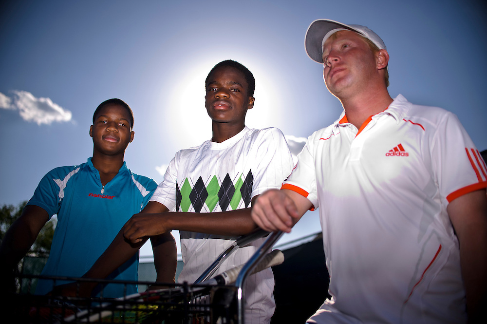 photo by Matt Roth.Friday, May 11, 2012.Assignment ID: 30125820A..Francis Tiafoe, middle, is the top-ranked 14-year-old tennis player in the country. He is flanked by his twin brother Franklin, left, and their coach Misha Kouznetsov, right, at the Tennis Center at College Park, Friday, May 11, 2012...His father immigrated from Sierra Leone in 1996. Francis's father, Constant lived where he worked at the Tennis Center at College Park, where Francis and his twin brother Franklin would occasionally sleep. Misha Kouznetsov, a tennis pro at the Center saw potential in Francis and has been training the twins since they were eight. Constant and his family have since moved into an apartment five minutes away, and the boys train and go to school full-time at the Center.