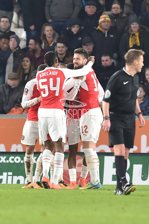 Arsenal celebrate their third goal to go 3-0 up during the The FA Cup fifth round match between Hull City and Arsenal at the KC Stadium, Kingston upon Hull, England on 8 March 2016. Photo by Ian Lyall.