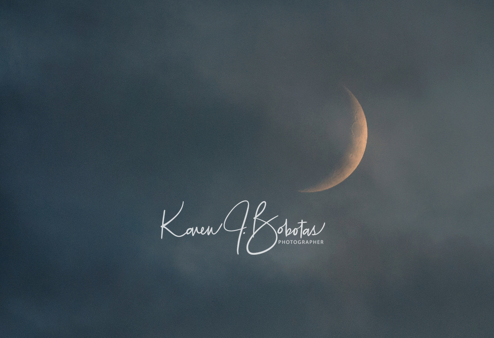 Crescent Moon in the clouds.  ©Karen Bobotas Photographer