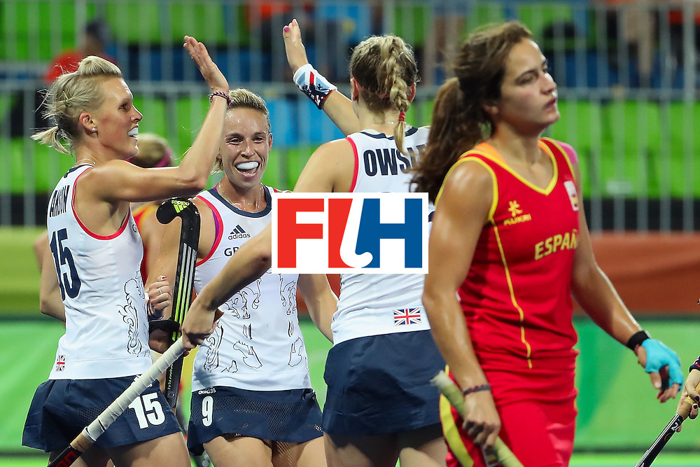RIO DE JANEIRO, BRAZIL - AUGUST 15:  (L-R) Alex Danson #15, Susannah Townsend #9 and Lily Owsley #26 of Great Britain celebrate after Owsley scored a first half goal against Spain during the quarter final hockey game on Day 10 of the Rio 2016 Olympic Games at the Olympic Hockey Centre on August 15, 2016 in Rio de Janeiro, Brazil.  (Photo by Christian Petersen/Getty Images)