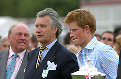 ARNAUD BAMBERGER and HRH PRINCE HARRY  at the Cartier International polo at Guards Polo Club, Windsor Great Park, on 30th July 2006.<br /><br />NON EXCLUSIVE - WORLD RIGHTS