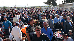 June 20, 2017 - Kilis, Turkey - June 20, 2017 - Kilis, Turkey: Turkey's decision to open its borders for Syrian refugees eyeing a return home to mark the upcoming Ramadan holiday received an overwhelming response. Braving long lines and sometimes pushing the metal barriers at two crossings, 114,000 Syrians have returned to their war-torn country since early June. Fearing a stampede, Turkish officials stepped up security measures on the border as more Syrians rushed to cross into the country ahead of the holiday, which starts this weekend. More than 30,000 Syrians crossed at the Öncüpınar border crossing in Kilis and 84,000 crossed at Cilvegözü in Hatay. Customs officials set up tents to protect refugees from the scorching sun while waiting and charities delivered meals for those breaking their Ramadan fast. (Credit Image: © Resit Celebioglu/Depo Photos via ZUMA Wire)