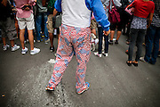 A man wearingUS-flag pants is standing on the street in Lower Manhattan, New York, USA, on the 10th anniversary of the 9/11 attacks on the Word Trade Centre.