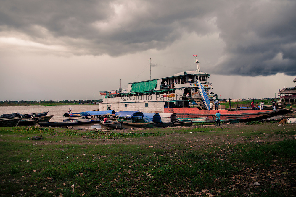 Santa Rosa, a Peruvian small village on the triple border between Brazil, Colombia and Peru in the amazon forest. A boat waiting for passengers to board for the 3 days trip to Iquitos, Peru.